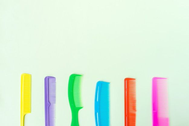 Many different multi-colored plastic hair comb crest brushes