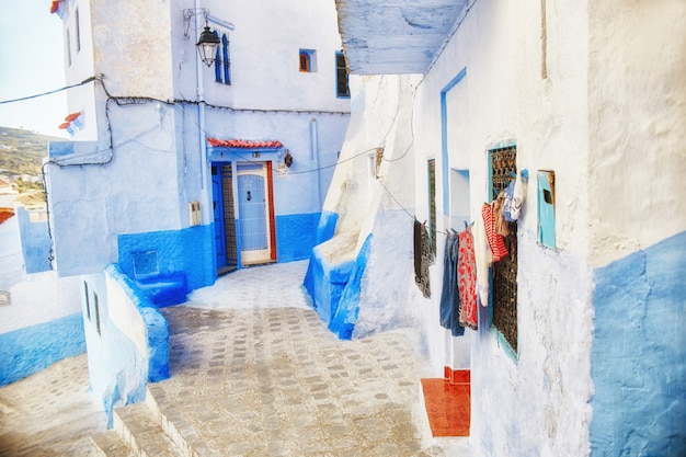 Many different souvenirs and gifts in the streets of chefchaouen. paintings, carpets, clothing