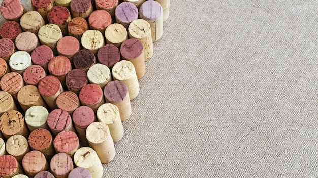 Many different wine corks with space for text.