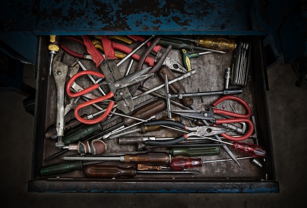 Many different work old tools in blue grudge steel drawer