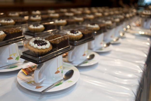 Many dish of cake and pie sandwich with coffee cup set up for tea break