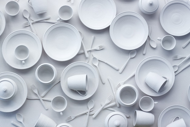 Many dishes and appliances are painted white on a white surface
