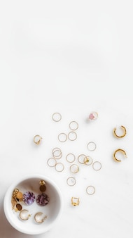 Many earrings on white marble table