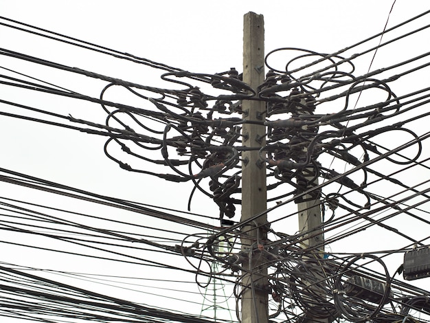 Many electrical cables, wires, telephone lines and cctv on electricity pole