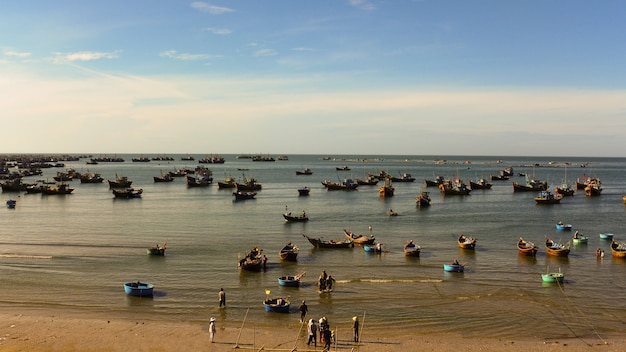 Many fishing boats float in the bay, fishing village in vietnam