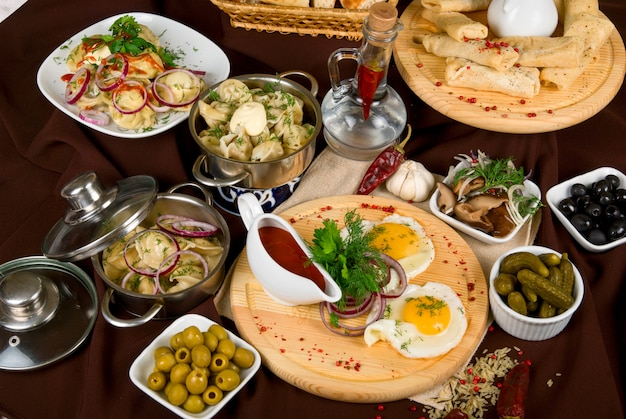Many food dishes on the restaurant table. close up.