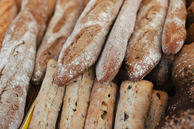 Many fresh baguettes in the bakery