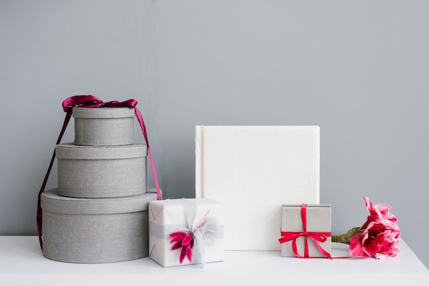 Many gift holiday boxes and wedding photo book