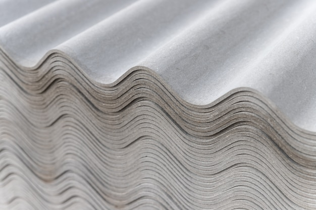Many gray slate sheets are stacked on top of each other. wavy stripes pattern