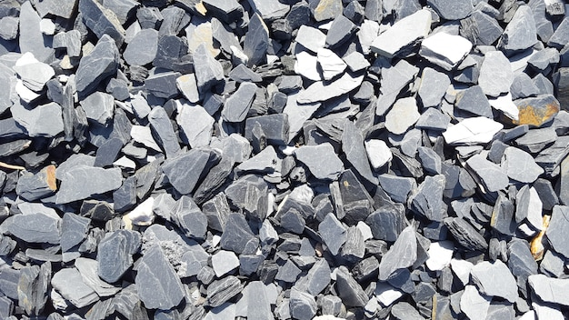Many gray stones as the texture of different shapes background