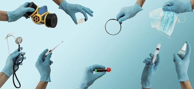 青で医療ツールを保持している多くの手