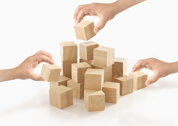 Many hands playing wooden box on isolated .