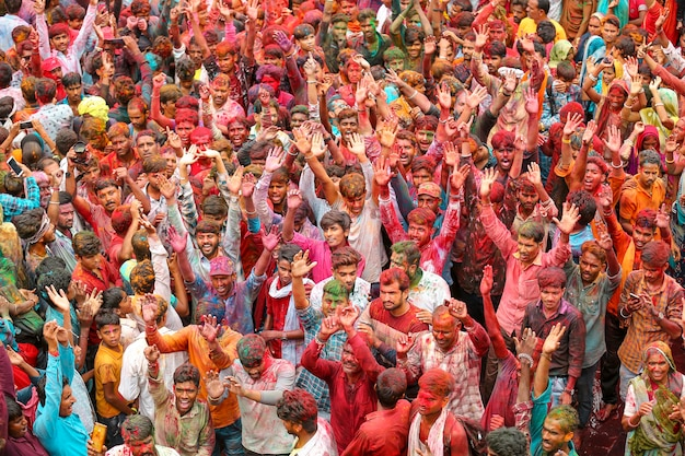 Many indian people throwing powder paint into the air holi festival premium photo