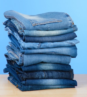 Many jeans stacked in a pile