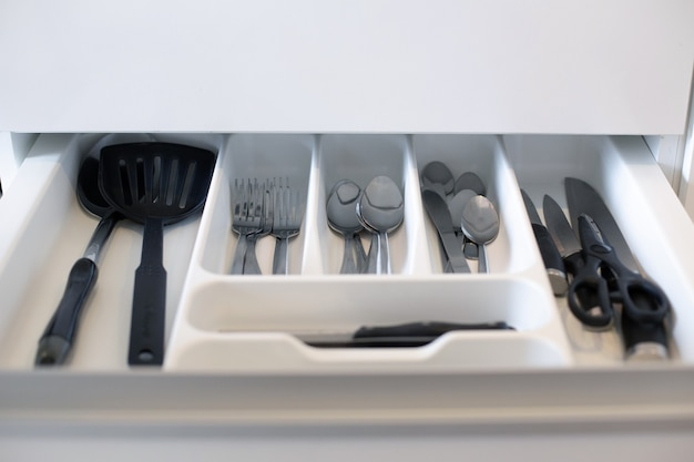 Many kitchen utensils are placed in desk