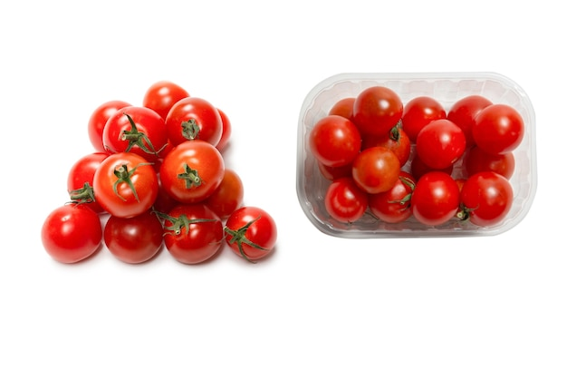 Many little cherry tomatoes isolated on  white background. group of cherry tomatoes.