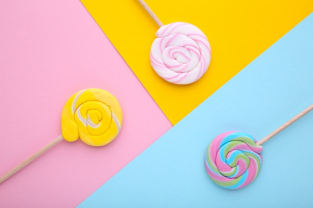 Many lollipops on colorful background, sweets.
