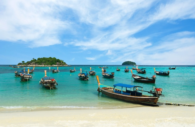 Many long-tailed boat on sunrise beach, koh lipe, thailand