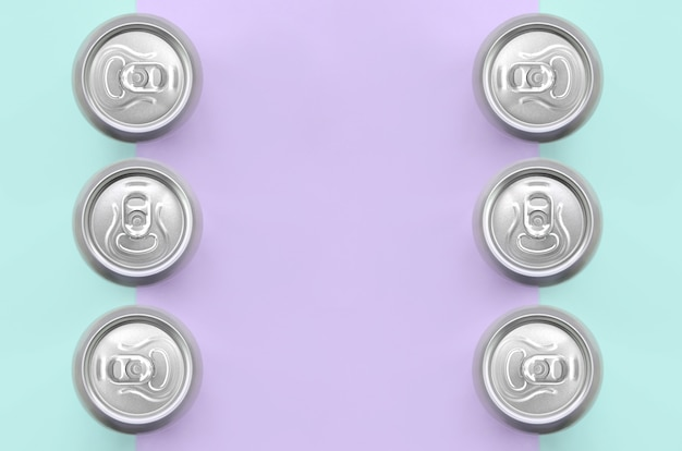 Many metallic beer cans of fashion pastel violet and blue colors paper in minimal concept