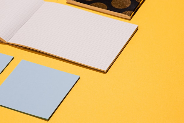 The many notebooks on yellow surface