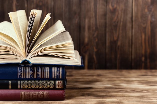 Many old books on wooden background