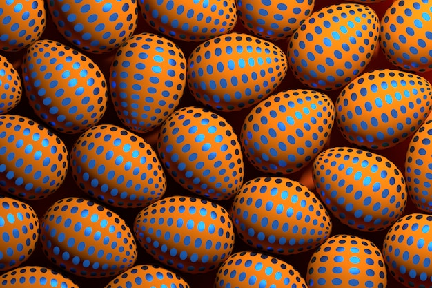 Many orange easter eggs with blue dotted pattern.