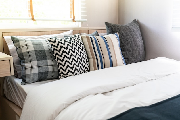 Many pillow on white bed