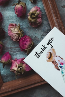 Many pink roses and a thank you card