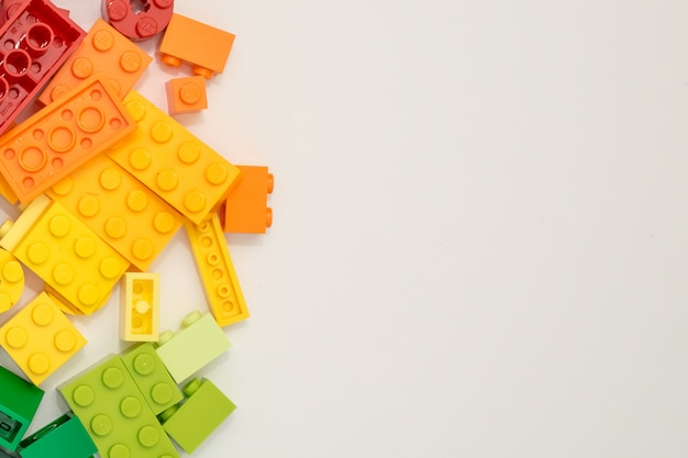Many plastic constructor cubes on white background. popular toys.