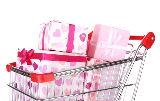 Many present boxes in shopping cart isolated