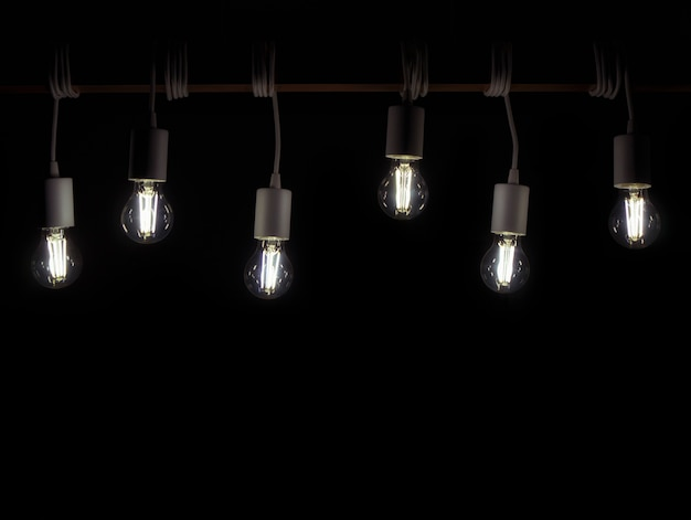 Many retro led lamps hanging on the wooden plank