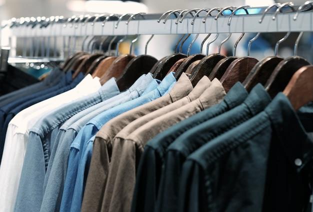 Many shirts hanging on a rack