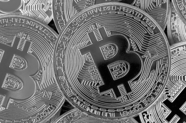 Many silver bitcoins. cryptocurrency and virtual money concept