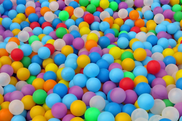 Many small colorful plastic balls in the pool