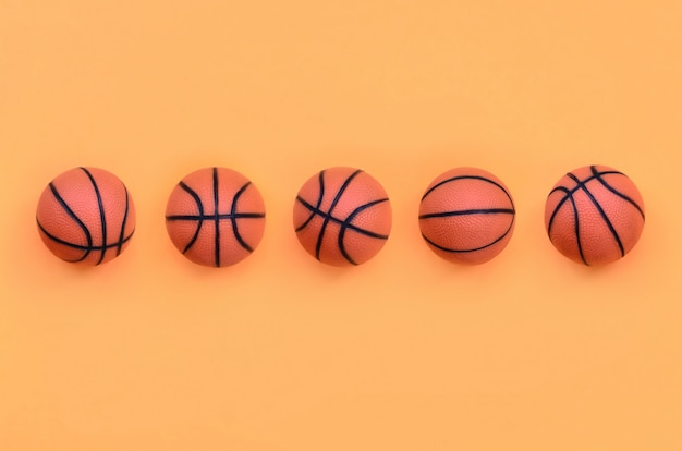 Many small orange balls for basketball sport game lies on texture background