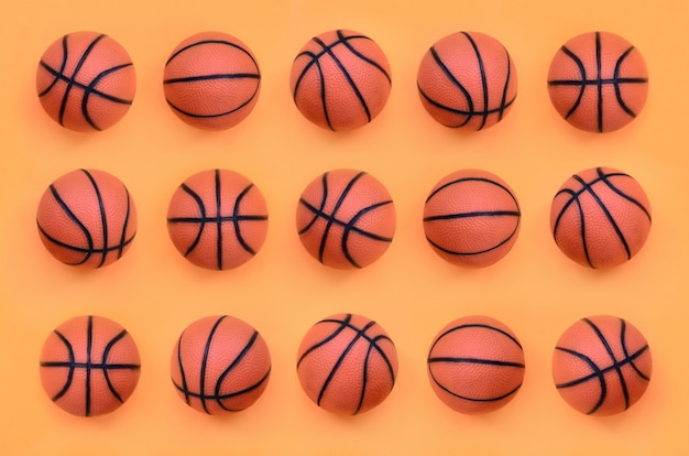 Many small orange balls for basketball sport game lies