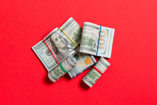 Many stack of 100 dollar bills. isolated on colored background top wiev with copyspace