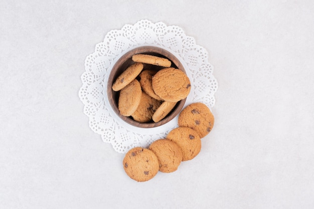Many of sweet cookies on wooden plate