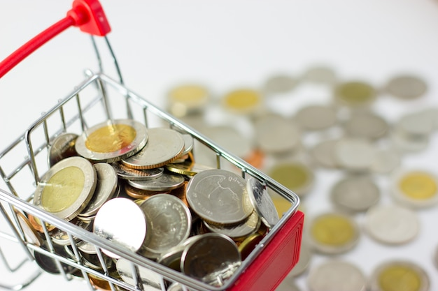 Many thai baht coins are in a red cart.