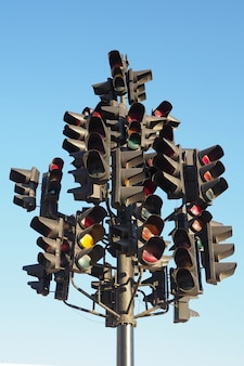 Many traffic lights on one post