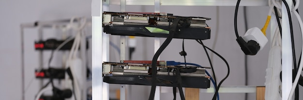 Many video cards are assembled into mining farm for cryptocurrency closeup