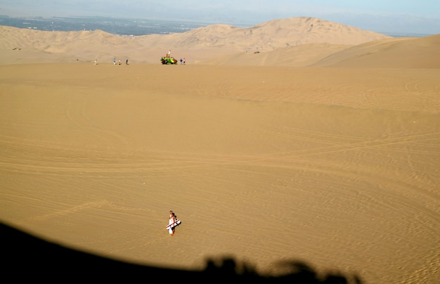 Many visitors enjoy the outdoors activities on huacachina desert, peru