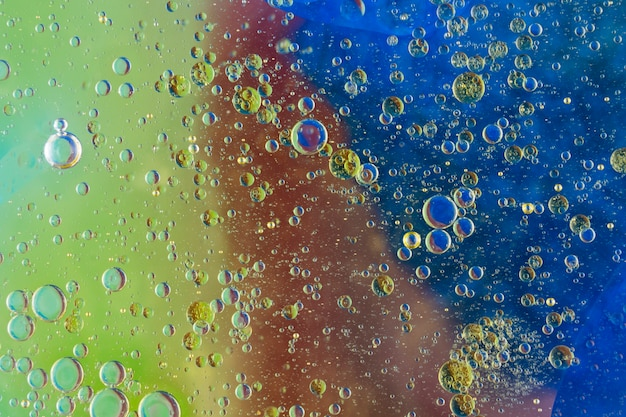 Many water bubbles over the painted textured background