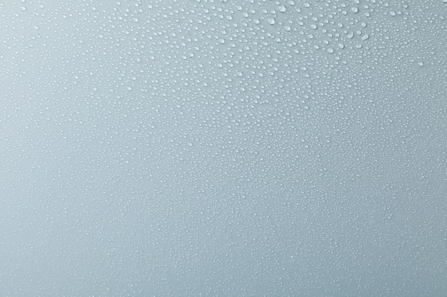 Many water drops on grey. texture, close up