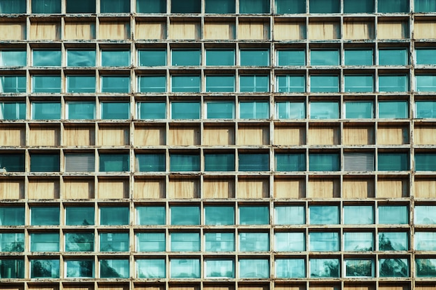 Many windows on facade of high-rise building