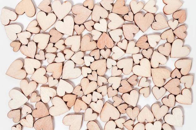 Many wooden hearts valentines day background. top view.