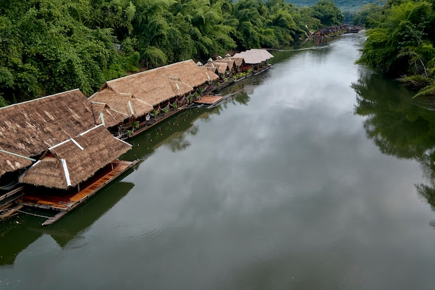 Many wooden house floating on the river