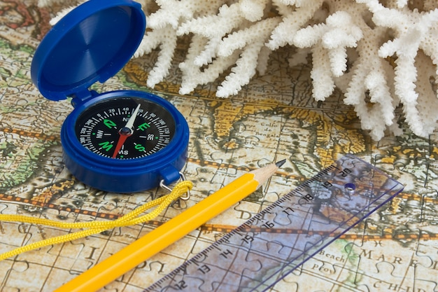 Map and coral, still life
