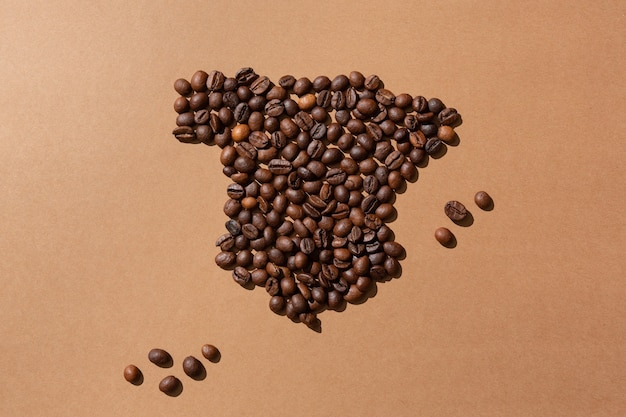 Map of spain made with coffee beans on brown surface