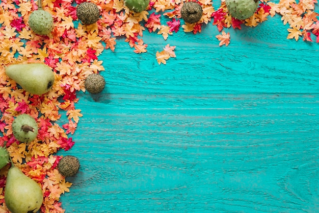 Maple leaves and organic products on wooden background
